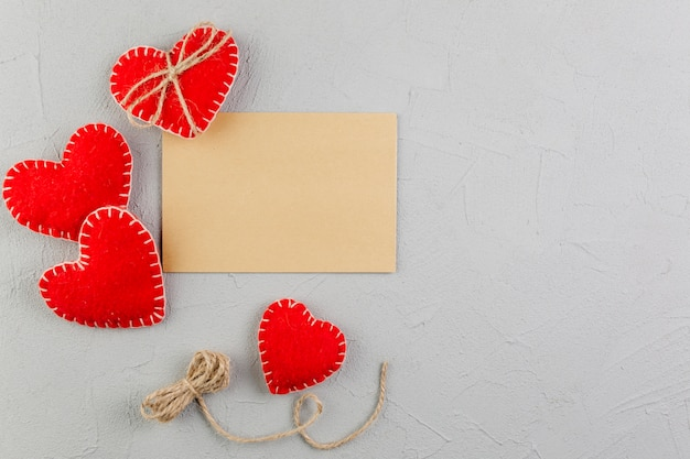 Blank brown paper between stuffed toy hearts