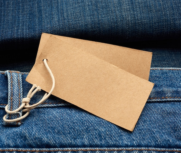 Blank brown rectangular tag tied in the back pocket