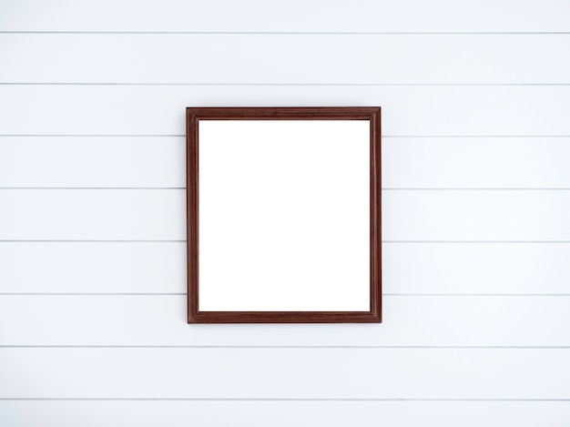 Blank brown square wooden picture frame on clean white wood plank wall.