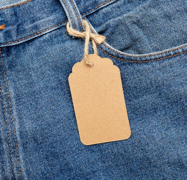 Blank brown tag tied to a pocket