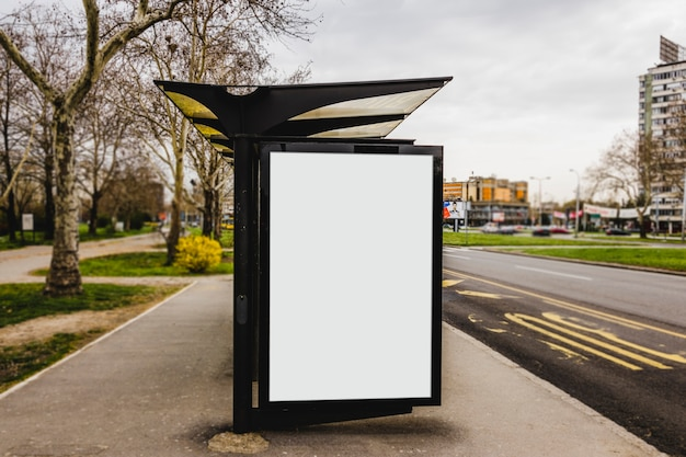Blank bus stop advertising billboard in the city