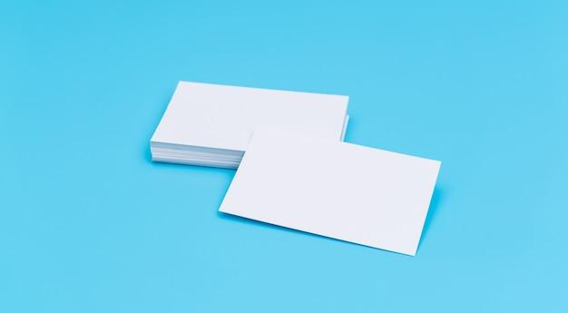 Blank business card on blue background .