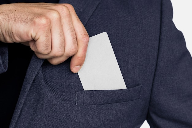 Blank business card in a business man's hand