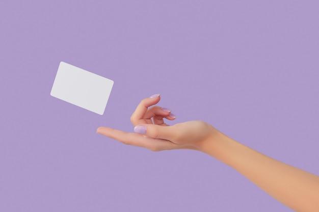 空白の名刺は、女性の手でラベンダーの背景に浮揚します