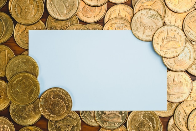 Blank business card or name card and stack of coin