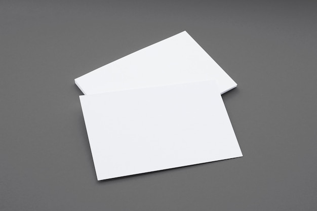 Blank business cards composition isolated on grey