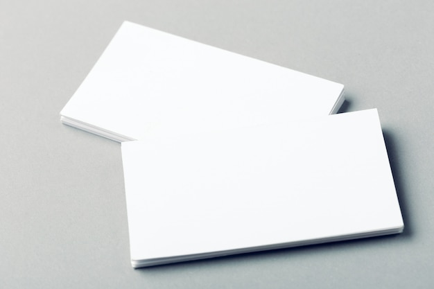 Blank business cards on grey