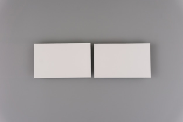 Blank business cards on light background. mock up for design and branding identity.