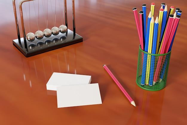 사무 용품 옆 나무 책상에 빈 비즈니스 카드.