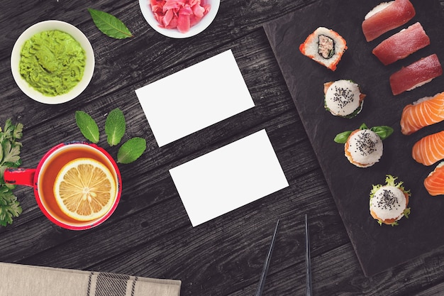 Blank business cards in a sushi bar scene