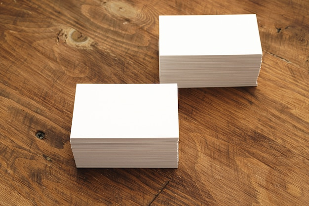 Blank businesscard stacks on rough wooden table