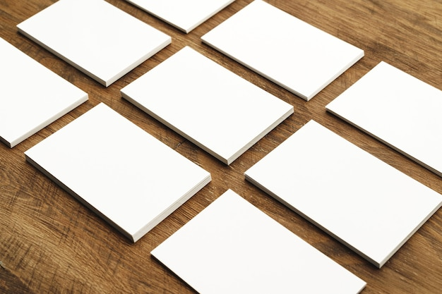Blank businesscard stacks on wooden table
