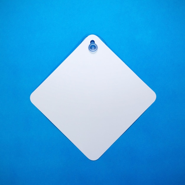 Blank car sign on blue paper background