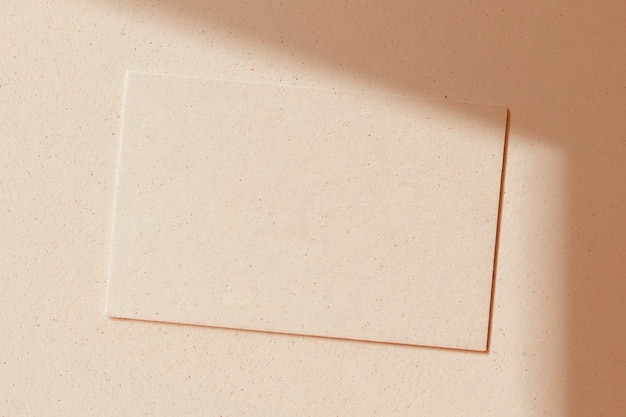 Blank card on a beige concrete