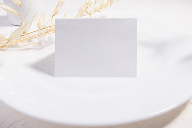Blank card or note with dry plants flower