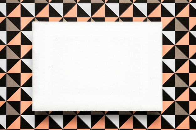 Blank card on patterned background