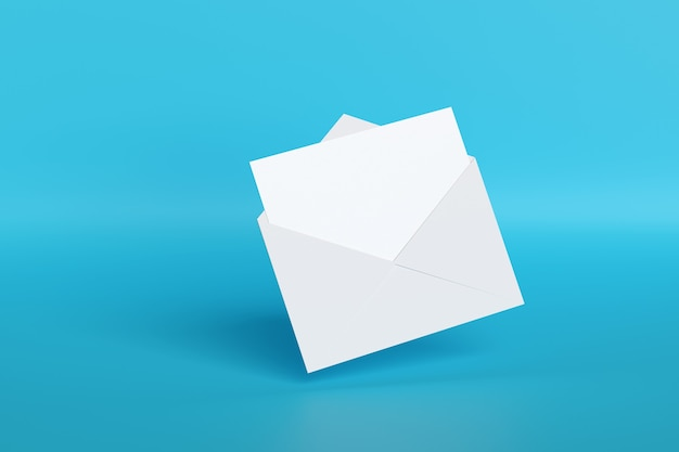 Blank card popping out of an envelope isolated on blue background.