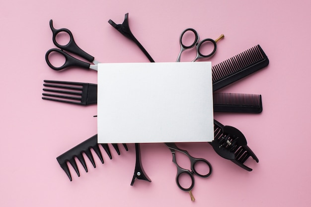 Blank card surrounded by hair tools