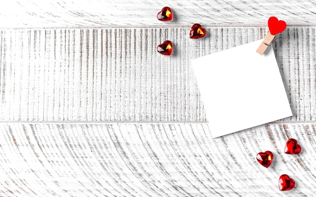 Blank card with a heart for your text on a wooden background. concept of valentine's day, love note. copy space.
