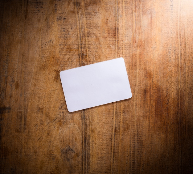 Blank card on wooden table