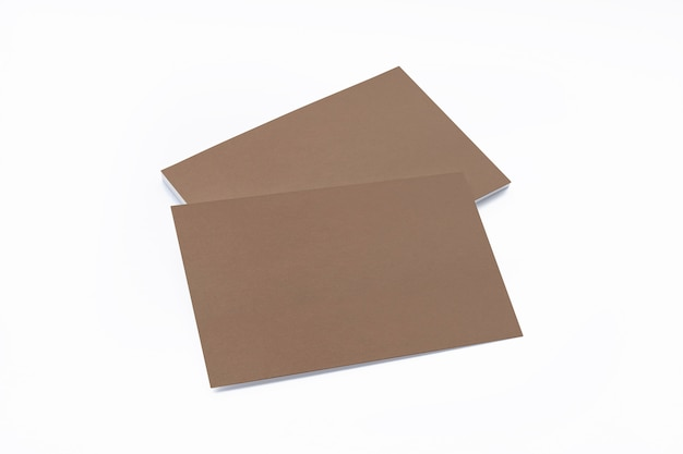 Blank cardboard business cards isolated on white