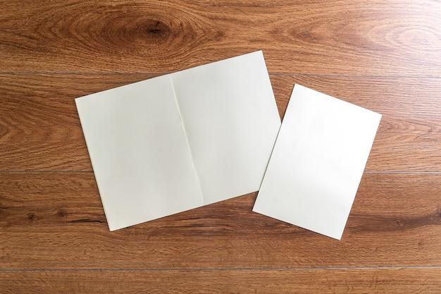 Blank catalog portrait  catalog book mock up on wood branding identity magazines