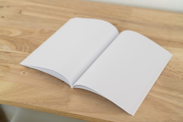 Blank catalogues on wooden table