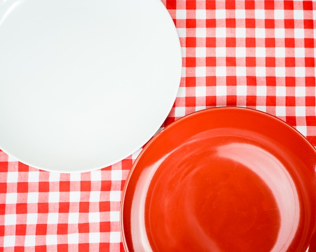 Blank ceramic plate or dish on dinner table with copyspace