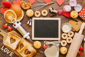 Blank chalkboard amidst pastry