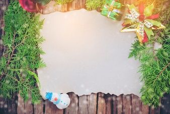 Blank Christmas card on wooden texture background with others decorating items