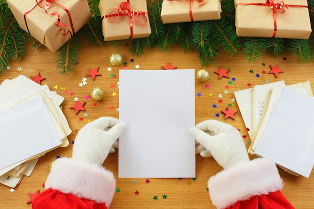 Blank christmas letter in santa claus hands