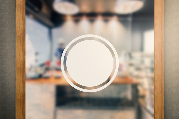 Blank circular sign on glass door with coffee shop background