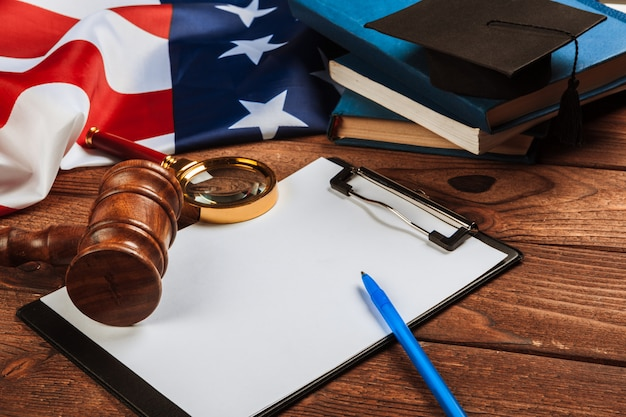 Blank clip board and usa flag on wooden table