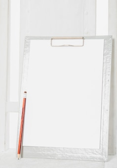 Blank clipboard on wooden chair