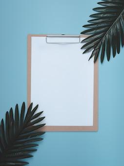 Blank clipboard on pastel.