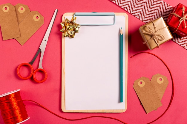 Blank clipboard pencil and little gifts
