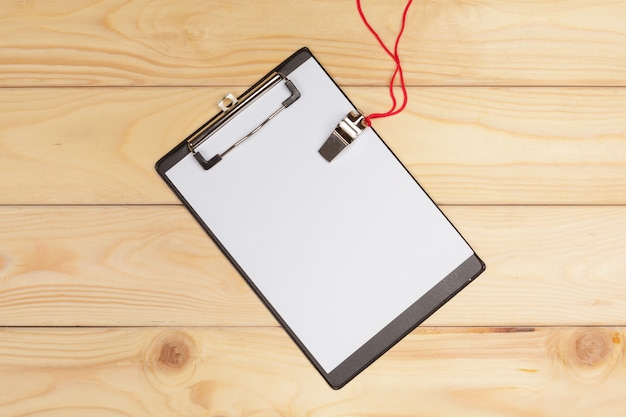 Blank clipboard and whistle