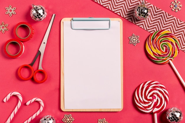 Blank clipboard with candy canes