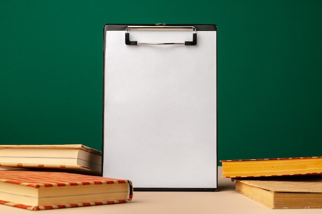 Blank clipboard with copy space and school supplies