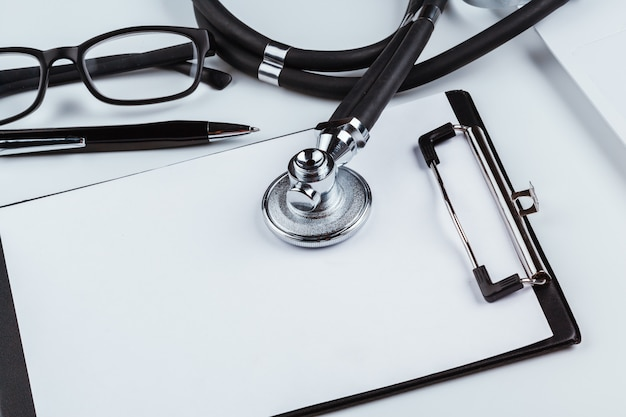 Blank clipboard with modern stethoscope