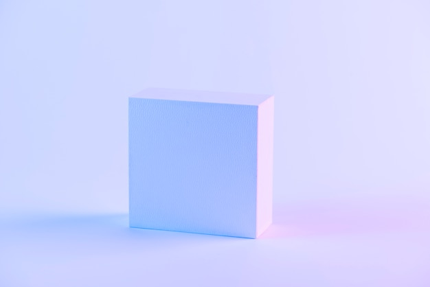 An blank closed box against purple background