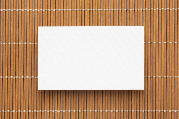 Blank corporate copy space business cards on brown background