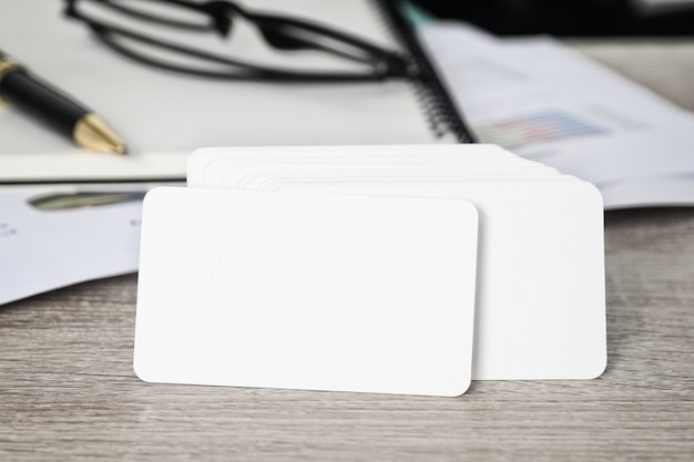 Blank corporate identity business card package on table