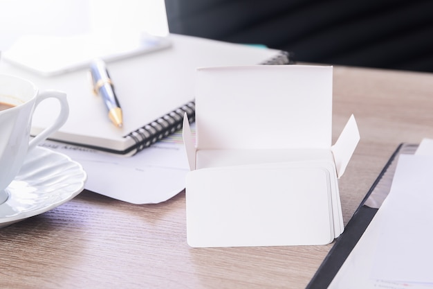 Blank corporate identity business card package on worker table