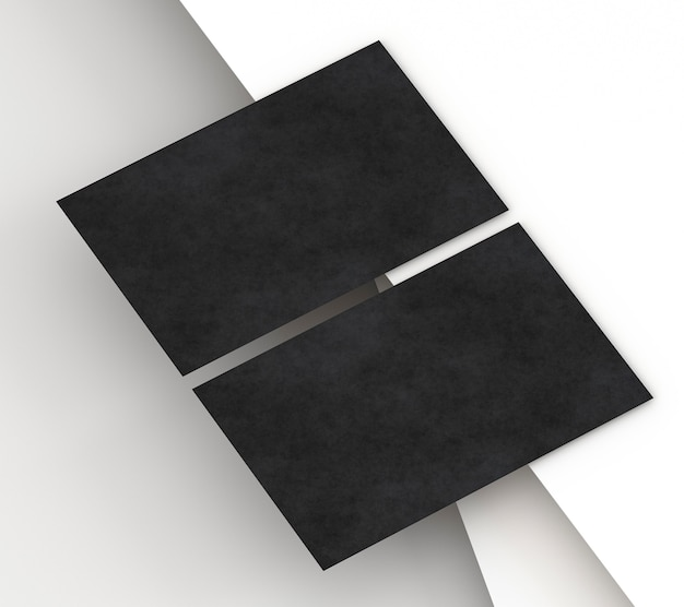 Blank corporate stationery black business card on paper