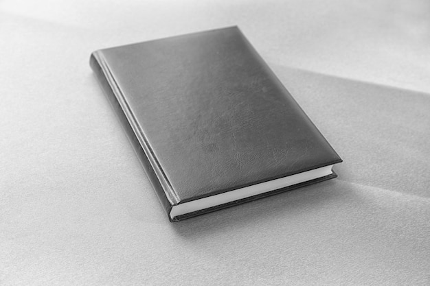 Blank cover of closed book on light