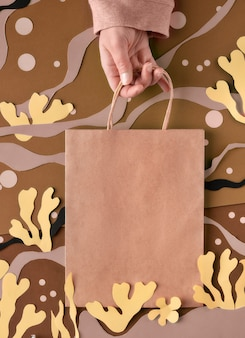 Blank craft paper bag on abstract sea underwater background. matisse-inspired craft paper collage.