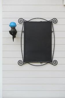 Blank dark mockup of vintage signboard