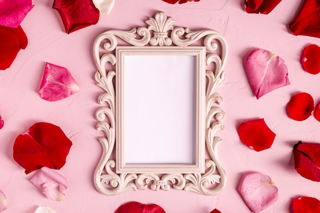 Blank decorative frame with rose petals