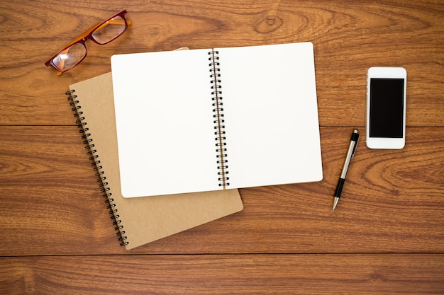 Blank diary on wood background